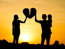 family holding broken heart at sunset