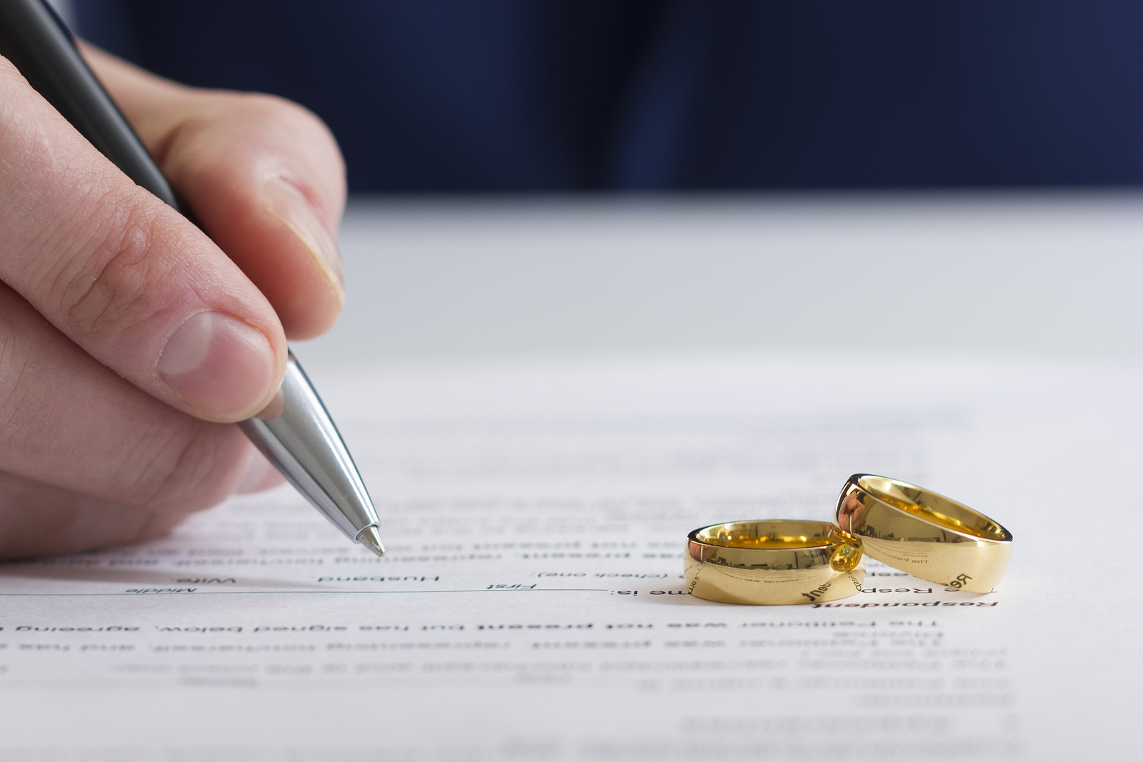 hand signing marital settlement agreement